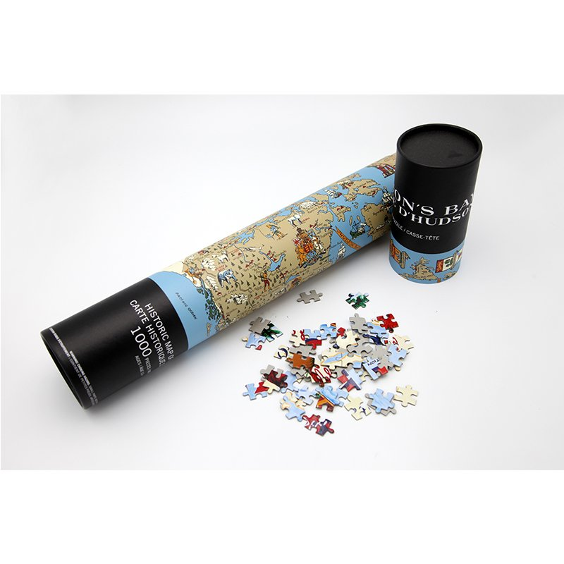 paper puzzles in cardboard packaging cylinder